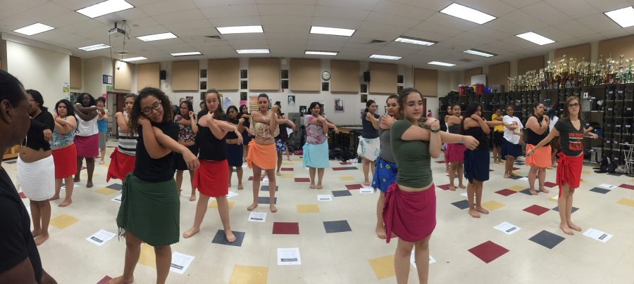 Chavez+Polynesian+Club+members+stretch+before+they+practice+their+narrative+dance+routines.+