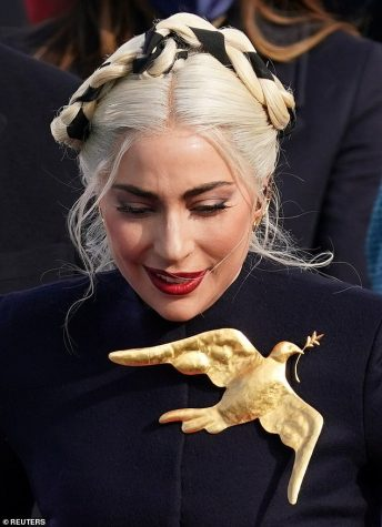 Lady Gaga and her gold dove.