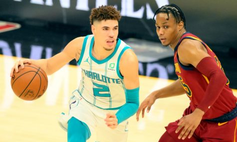 Dec 23, 2020; Cleveland, Ohio, USA; Charlotte Hornets guard LaMelo Ball (2) moves the ball against Cleveland Cavaliers guard Isaac Okoro (35) in the first quarter at Rocket Mortgage FieldHouse. Mandatory Credit: David Richard-USA TODAY Sports