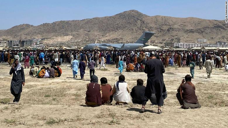 FILE - In this Aug. 16, 2021, file photo, hundreds of people gather near a U.S. Air Force C-17 transport plane along the perimeter at the international airport in Kabul, Afghanistan. In the U.S. departure from Afghanistan, China has seen the realization of long-held hopes for a reduction of the influence of a geopolitical rival in what it considers its backyard. Yet, it is also deeply concerned that the very withdrawal could bring instability to that backyard - Central Asia - and possibly even spill over the border into China itself in its heavily Muslim northwestern region of Xinjiang. (AP Photo/Shekib Rahmani, File)